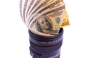 Camera lens full of money