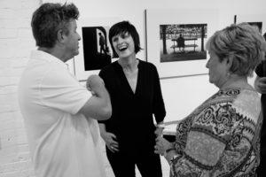 Valerie during photo exhibit opening