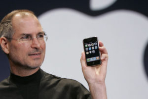 ****FILE***  Apple CEO Steve Jobs holds up an Apple iPhone at the MacWorld Conference in San Francisco, Jan. 9, 2007. Apple Inc., on a tear with its popular iPod players and Macintosh computers, is expected to report strong quarterly results Wednesday. (AP Photo/Paul Sakuma) ORG XMIT: CAPS105
